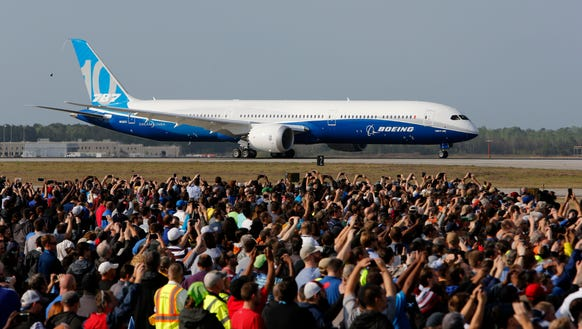 Boeing employees raise up their camera phones to record