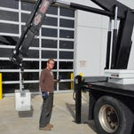 Eric Venable is one of the owners of Sierra Scales, a family-run business in Dayton. He is directing the removal off the company truck of 1,000-pound scale weights for relocation to a new business.