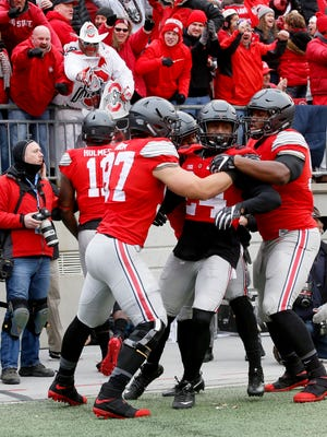 Ohio State's Malik Hooker celebrates with teammates after returning an interception for a touchdown against Michigan at Ohio Stadium on Saturday, Nov. 26, 2016.