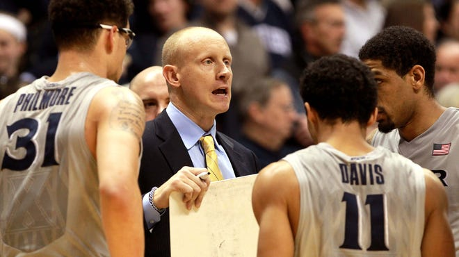 Xavier head coach Chris Mack talks to his team during a March 16 game against Providence.