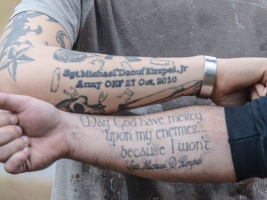 Justin Leasure and John Lowe share similar tattoos honoring Sgt. Michael Kirspel Jr., who was killed by an improvised explosive device while on deployment with them. Leasure and Lowe said their friend almost made it to the end of their deployment.