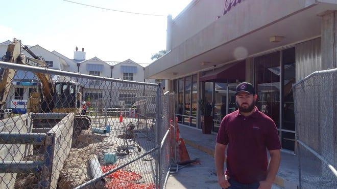 Sebastiano Setticasi, whose family owns Josie's Ristorante in Boynton Beach, stands Friday between the restaurant and neighboring construction.