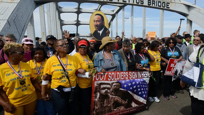 Foot soldiers of the movement commemorate the 50th anniversary of Bloody Sunday by leading a march of thousands across the Edmund Pettus Bridge in Selma on Sunday.