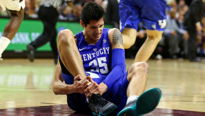 Feb 20, 2016; College Station, TX, USA; Kentucky Wildcats forward Derek Willis (35) holds his leg after a play during the second half against the Texas A&M Aggies at Reed Arena. and the #Aggies ran past Ole Miss 71-56. #12thMan #AggieHoops Mandatory Credit: Troy Taormina-USA TODAY Sports