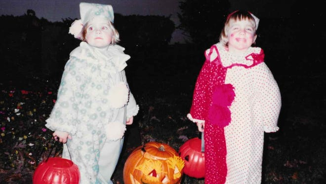 Twin sisters Maureen (left) and Megan Finnerty trick or treat in the early '80s in Long Beach, Ind. They wear costumes made by their mother.