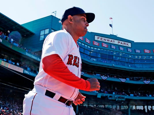 Boston Red Sox manager Alex Cora runs onto the field as he is introduced during ceremonies prior to a home opener baseball game against the Tampa Bay Rays at Fenway Park in Boston, Thursday, April 5, 2018. (AP Photo/Charles Krupa)