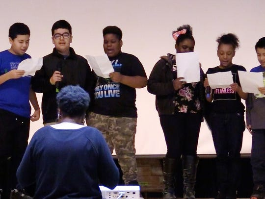 Poughkeepsie Middle Model School students perform an