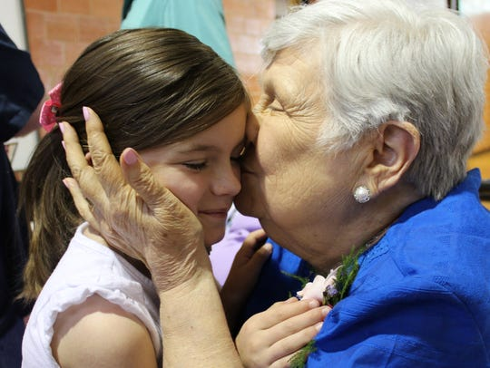 Christene Cooper kisses great-granddaughter Lila Taylor
