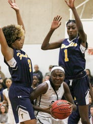 Rutgers Prep's Jasmine Lyles tries to take a shot as