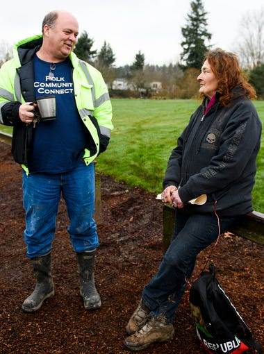 Joan, right, talks to Zach Tresch, left, with City Vibe, at Wallace Marine Park during the Point-in-Time homeless count on Wednesday, Jan. 31, 2018. Joan, 60, has lived in the park for more than five years, and says the 100-plus people who camp in the park make up a tight-knit community.