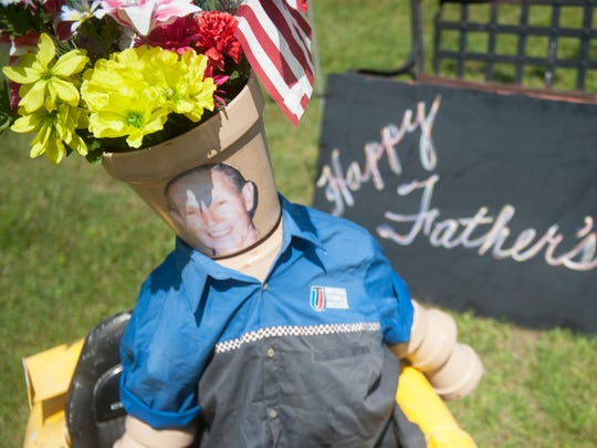 Sisters Kathy and Lisa Pontelandolfo created a Pot Man display in Mantua with a Father's Day theme.