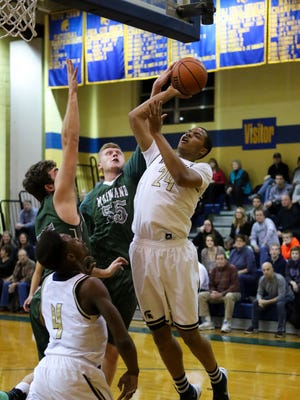 Tyler Jones of Holy Spirit goes up for a shot during a recent game against Mainland. The senior forward is averaging better than 20 points per game.