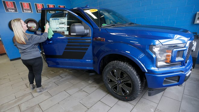Emily Knope, a Gordie Boucher Ford sales consultant, wipes off the door of a 2018 Ford F-150 on Wednesday at Gordie Boucher Ford, N88 W14300 Main St. in Menomonee Falls. The Ford F-150 was the top-selling vehicle for 2017 vehicle sales. It's a distinction it has held for at least 36 years.