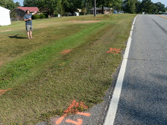 Terrie Brown of Starr stands near paint markings on the side of Flat Rock Road in Starr, where George Eugene Williams, 73, of Iva car broke down and later was struck by a passing car and killed Monday.  Brown said she saw the hit-and-run, in which a Burgundy color four-door sedan similar to a Ford Taurus struck Williams.