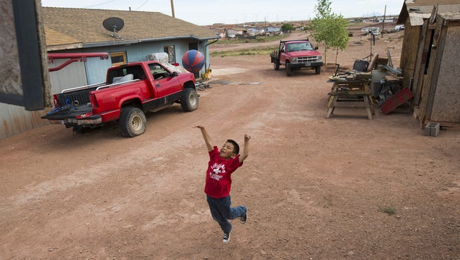 Emmanuel Peters, 6, shoots baskets at his home in Cameron, Ariz. Many residents lack sufficient housing on the Navajo Nation and are put on long waiting lists by the Navajo Housing Authority.