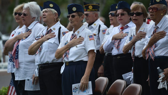 Attendees stand during the Memorial Day ceremony at Sebastian's Riveview Park on May 30, 2016, in Sebastian.