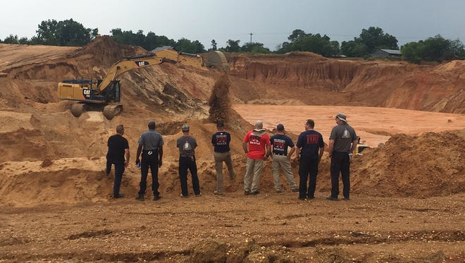Recovery efforts to remove two men buried under 10-12 feet of rubble after a landslide continued after more rain pummeled the gravel pit in Copiah County on Friday.