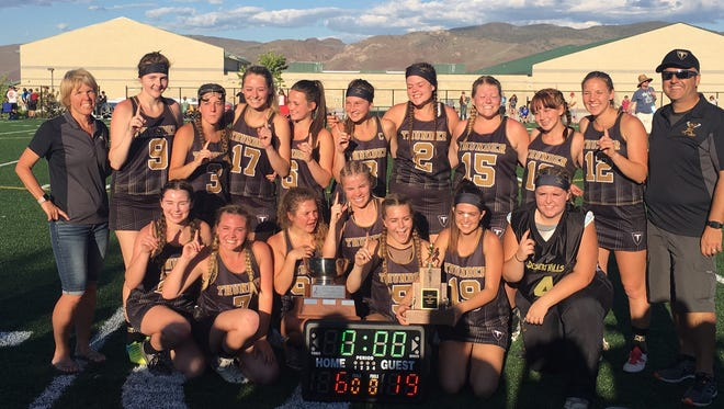 The Desert Hills lacrosse team poses for a picture after taking home the Nevada state championship with a 19-6 victory over Galena in Reno, Nevada.