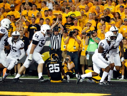 Penn State players celebrate after Iowa running back