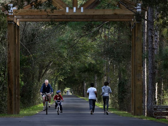Walkers and riders on the St. Marks Trail. The Christmas Eve Run to Posey's follows a 15.6 mile section of the Historic Railroad State Trail.