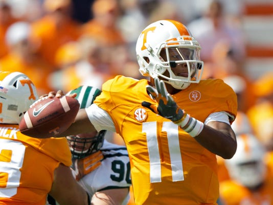 Tennessee quarterback Joshua Dobbs (11) throws to a receiver in the first half of an NCAA college football game against Ohio Saturday, Sept. 17, 2016, in Knoxville, Tenn. (AP Photo/Wade Payne)