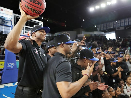 Memphis East coach Anfernee Hardaway joins his players in celebrating their win over Whitehaven during the AAA championship game on March 17, 2018 at the Murphy Center Complex in Murfreesboro.