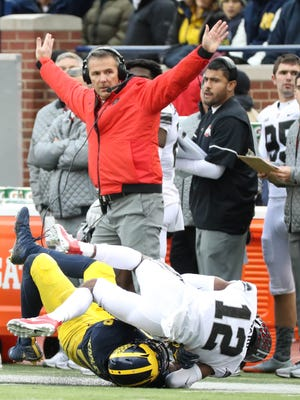 Ohio State coach Urban Meyer signals after a pass play in the second quarter of the 31-20 win over Michigan on Saturday, Nov. 25, 2017 at Michigan Stadium.
