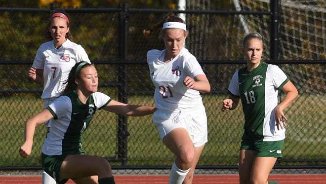 Red Hook's Casey Shein, center, tries to keep control of the ball during the 2017 Section 9 Class A girls soccer final against Cornwall at Franklin D. Roosevelt High School