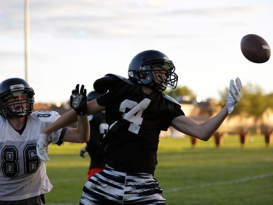 A Marshfield football player is intercepted during