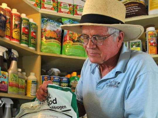 Dave Grover, owner and founder of Sun Harbour Nursery in Indian Harbour Beach, has been a proponent of slow release, low phosphorous fertilizer and organic fertilizers for years. He is a supporter of regulations for fertilizer, but thinks it should be uniform across the county. Grover with bag of fertilizer with slow release nitrogen and zero phosphorus.