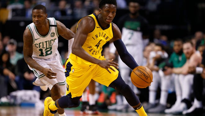 Pacers guard Victor Oladipo (4) steals the ball from Boston Celtics guard Terry Rozier (12) during the first half at TD Garden.