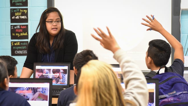 In this file photo, Patricia Anub, a seventh-grade social studies teacher at F.B. Leon Guerrero Middle School, engages her students.