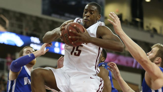 IUPUI's DavRon Williams grabs a rebound against Indiana State at the Fairgrounds Coliseum Friday November 14, 2014.