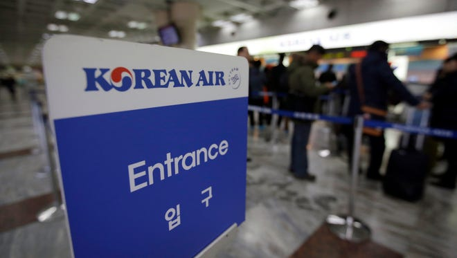 Passengers wait to buy tickets at a Korean Air Lines ticketing counter at Gimpo airport in Seoul, South Korea, Tuesday, Dec. 9, 2014. Korean Air apologized Tuesday for inconveniencing passengers after the daughter of its chairman ordered a crew member off a flight for serving bagged nuts in the first class cabin. (AP Photo/Lee Jin-man)