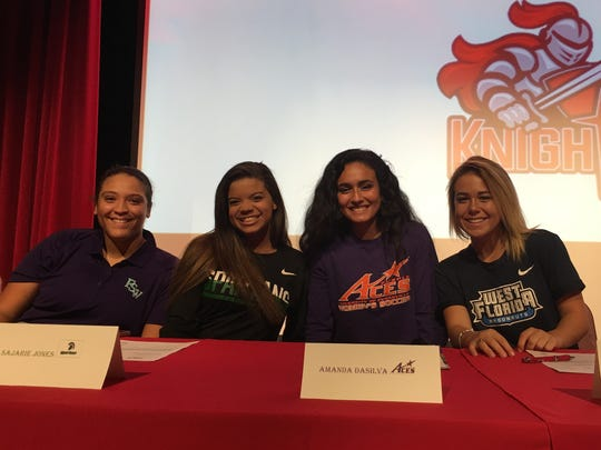 North Fort Myers High softball players, from left, Natavia Ellis (FSW) and Sajarie Jones (USC Upstate) and soccer players Amanda DaSilva (Evansville) and Taylor Kruse (West Florida) participate in signing day ceremonies Wednesday, Feb. 7, 2018.