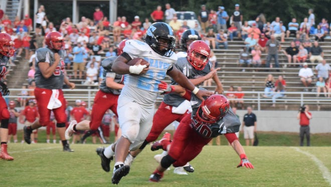 UC Brave Dante Smith makes his way past Hancock Co. players toward the end zone.