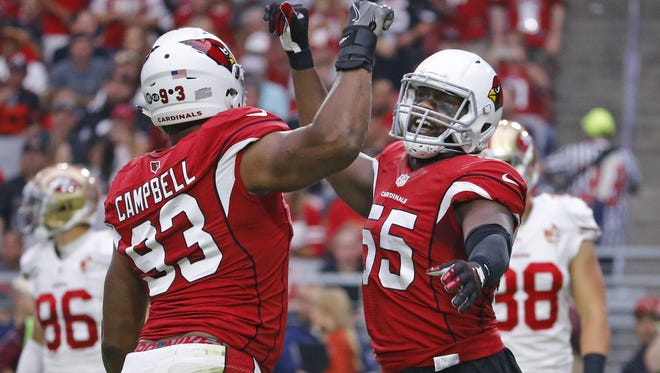 Cardinals outside linebacker Chandler Jones (55) celebrates with defensive end Calais Campbell (93) after he sacked 49ers quarterback Colin Kaepernick (7) in the first quarter Sunday, Nov. 13, 2016 in Glendale,  Ariz.