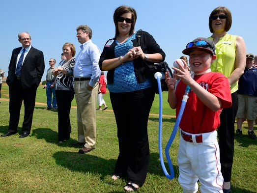 Copeland Spires and his mother Meg Spires look on excitedly during the groundbreaking ceremony for the Prattville YMCA Field of Dreams at the Willis Bradford Branch of the Prattville YMCA in Prattville, Ala. on Wednesday June 18, 2014.