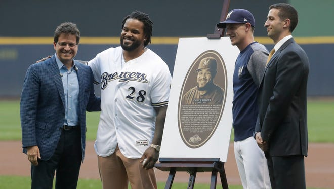 Former Brewer Prince Fielder is honored Tuesday at Miller Park with induction into the team's Wall of Honor. With Fielder are (from left) owner Mark Attanasio, manager Craig Counsell general manager David Stearns.