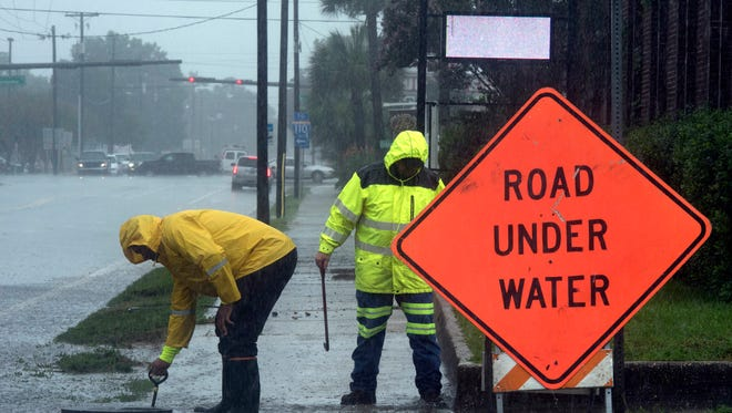 State crews work to ease street flooding at the intersection of 9th Ave. and Jackson Street Wednesday afternoon June 21, 2017.