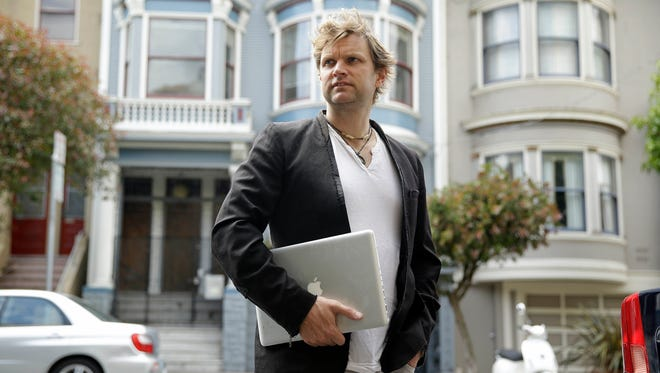 Gerry Kelly, founder of clothing brand Sonas Denim and a Bubblews user, poses near his home in San Francisco. Kelly has already earned nearly $100 from Bubblews since he began using a test version in January. His Bubblews feed serves as a journal about the lessons he has learned in life, as well as a forum for his clothing brand.