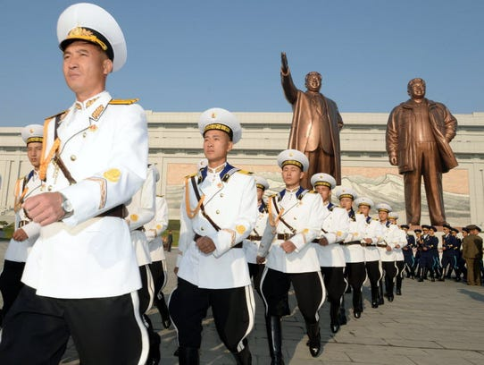 North Korean military personnel march as they visit