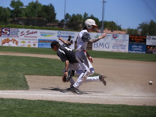 The Flat Bill Ducks' Steele Justis reaches first base safely after a throwing error by the Demons on Saturday at Ricketts Park.
