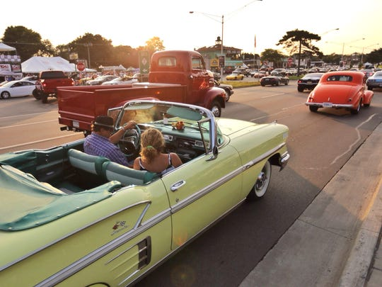 Cruisers make their way along Woodward Ave. in Royal Oak during the 2014 Woodward Dream Cruise on Friday August 15, 2014.