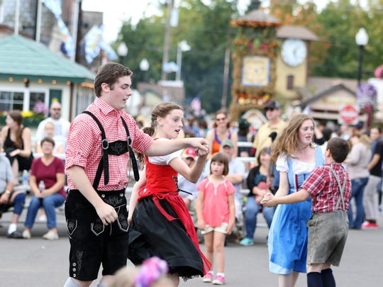 Tony Beyer, left, Kathryn Beyer, Carolyn Beyer and Brian Beyer dance in front of a crowd at the Mount Angel Oktoberfest.