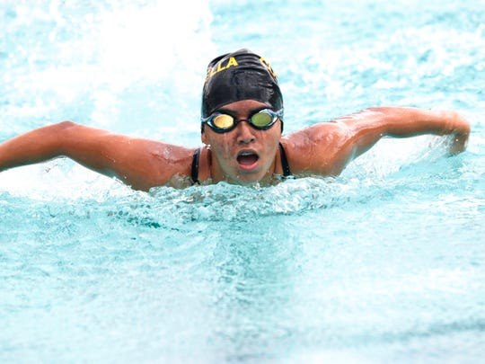 Magali Barajas of Coachella Valley High School wins the Girls' 100 Yard Butterfly in heat 2 of 3 during the De Anza league finals at Furbee Aquatic Center in Desert Hot Springs on May 2, 2018.