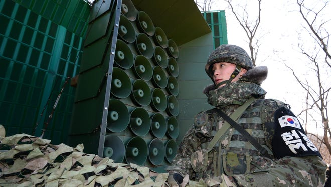 An undated photo made available on Feb.16, 2017 shows a South Korean soldier standing near loudspeakers at the border with North Korea, at an undisclosed location in South Korea.