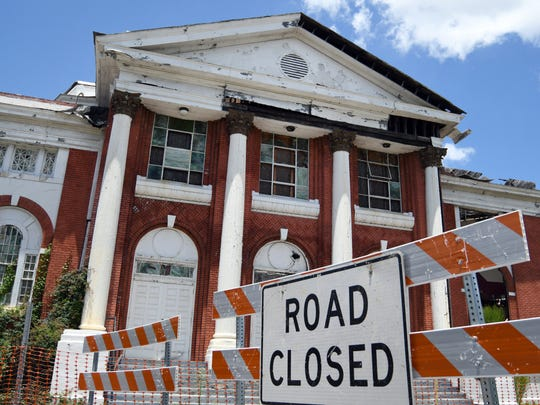 Signs and barricades were placed on the corner of Main Street and Fifth Avenue at Mount Carmel Baptist Church. The streets were closed after Hattiesburg officials learned the building, severely damaged by a tornado in 2013, was in imminent danger of collapse.