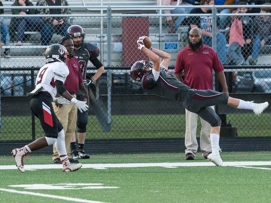 Snow Hill's Seth Woods (7) catches a pass during a