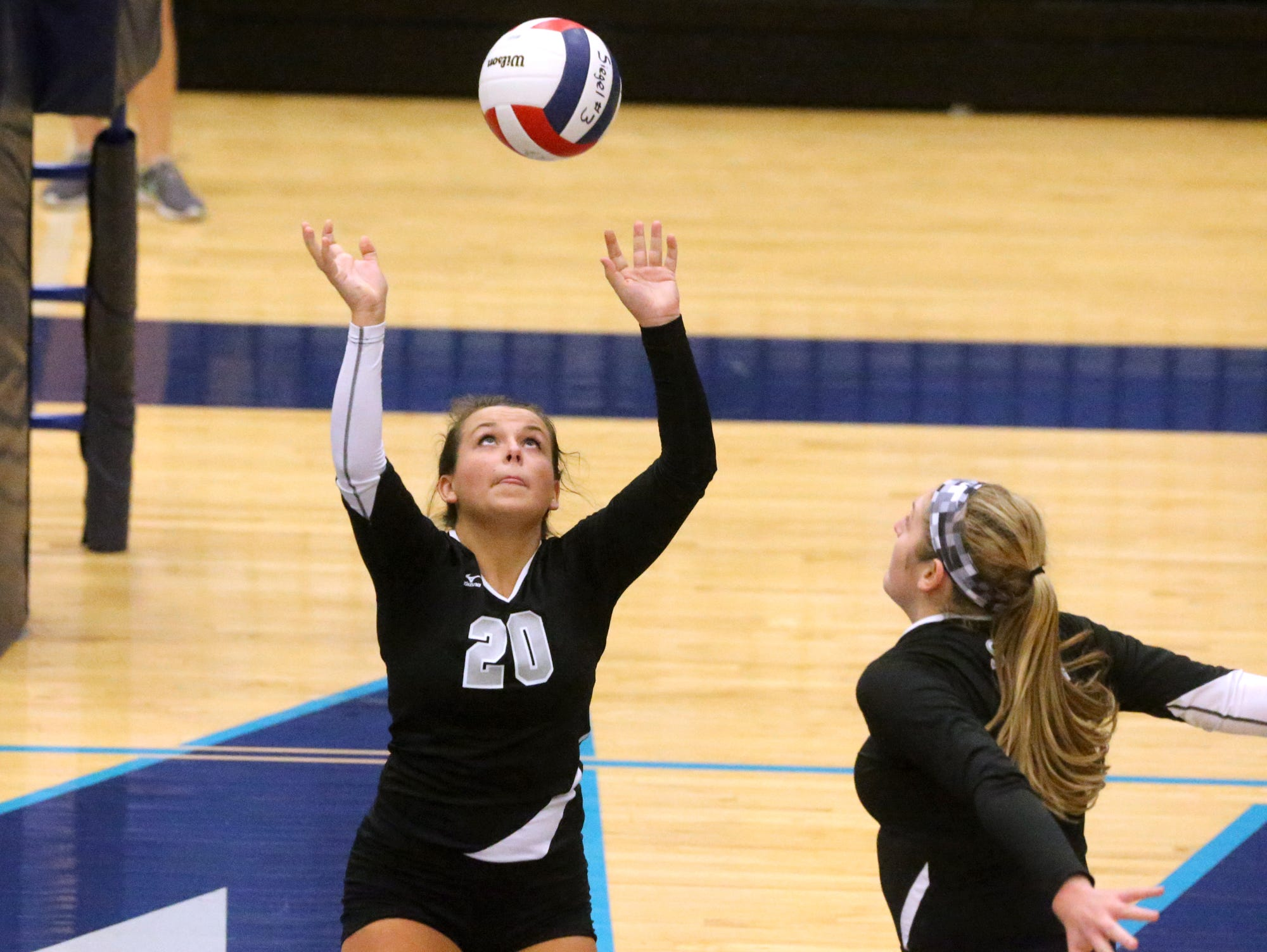Siegel's Kristin Demonbreun (20) sets the ball for Katelyn Lester (25) during the Region 4-AAA volleyball Championship against Blackman, on Tuesday, Oct. 13, 2015, at Siegel.